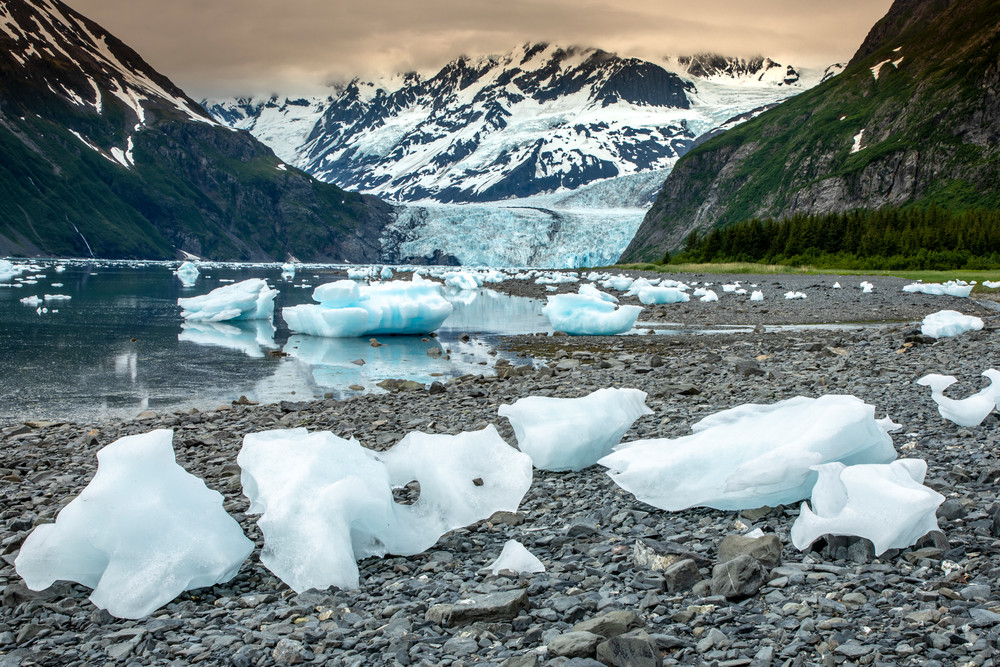 Land-locked ice bergs on shore at low tide in front of Surprise Glacier and Chugach Mountains in Harriman Fjord of Prince William Sound.  Summer Alaska                                       Photo by Jeff Schultz/SchultzPhoto.com  (C) 2018     ALL RI