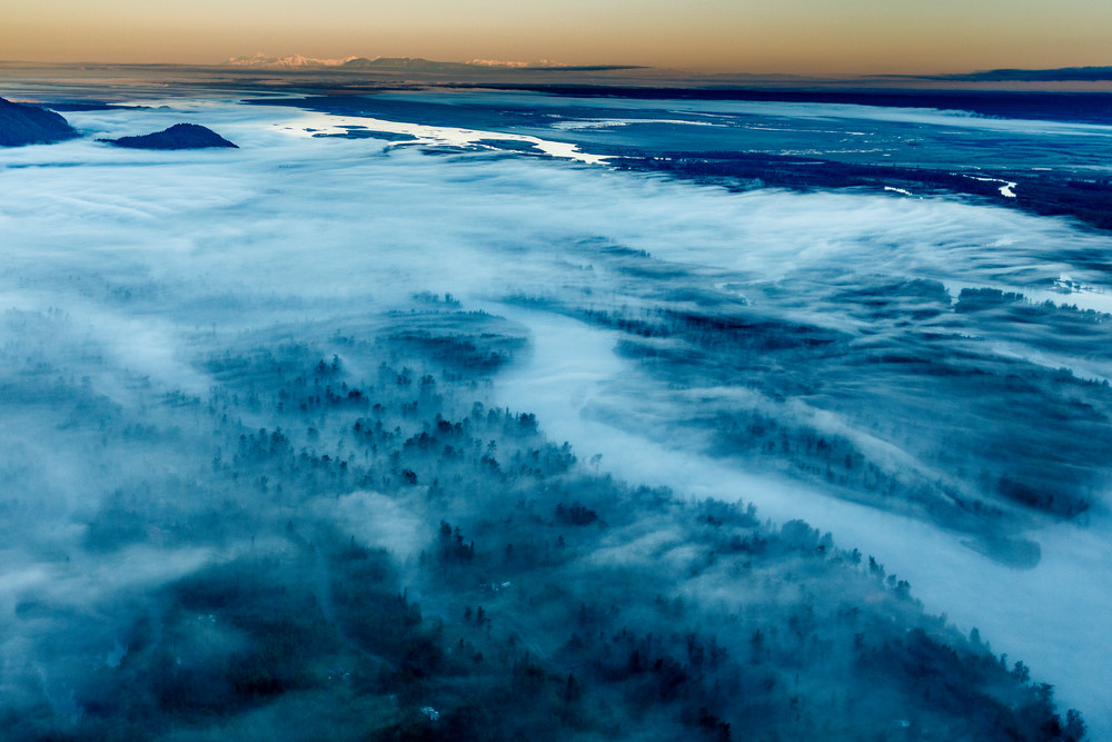 Summer landscape aerial view of fog over Knik River at sunrise Southcentral, Alaska  Photo by Jeff Schultz/  (C) 2020  ALL RIGHTS RESERVED