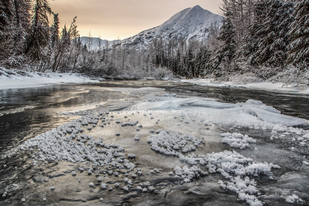 Winter landscape of partially frozen Granite Creek with hoar frost and Kenai Mountains in the Turnagain Pass area of Kenai Penninsula Alaska   Photo by Jeff Schultz/www.schultzphoto.com