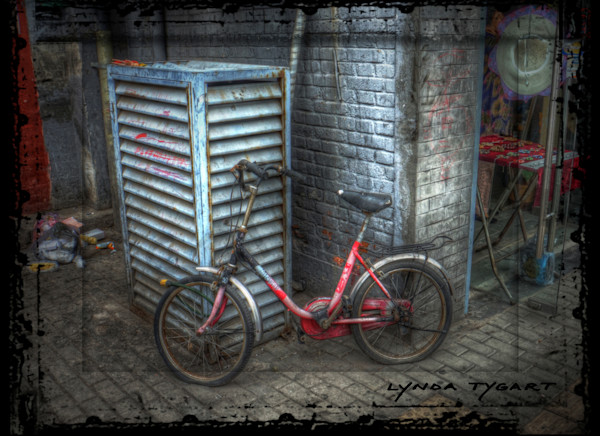 Lynda Tygart Bicycle in Beijing China with Flat Tires – Fine Art Photographs Prints on Canvas, Paper, Metal & More.