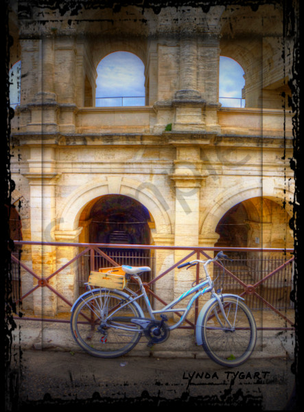 Lynda Tygart Bicycle in Arles France Europe near Colliseum – Fine Art Photographs Prints on Canvas, Paper, Metal & More.