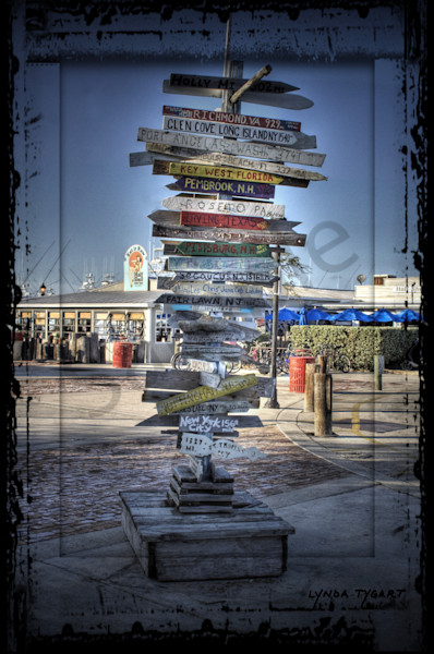 Lynda Tygart Directions Sign in Key West Florida – Fine Art Photographs Prints on Canvas, Paper, Metal & More.