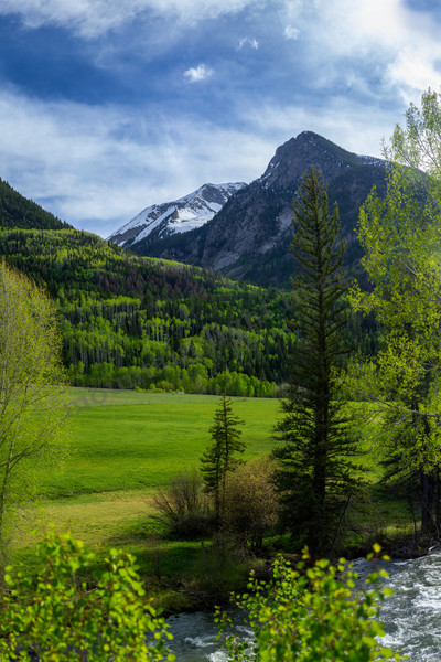 mountain light images, Crystal River Valley, Marble Colorado spring green clouds meadow blue sky