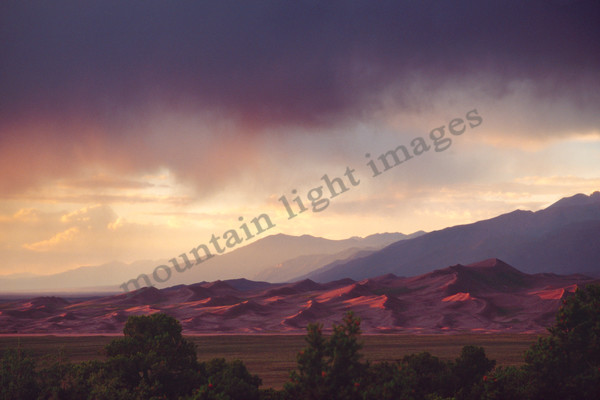 mountain light images great sand dunes park summer sunset with storm clearing off