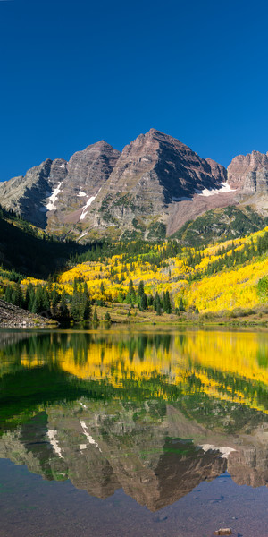 mountain light images fall at maroon lake on a colorful morning golden aspen glow in the morning light as the maroon bells take on a hint of their namesake color