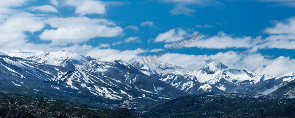 mountain light images snowmass ski area panorama in colorado after an early september snow mount daly and capital peak behind under blue sky and clouds