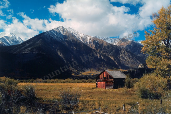 mountain light images twin lakes colorado looking at twin peaks in fall blue sky and white puffy clouds