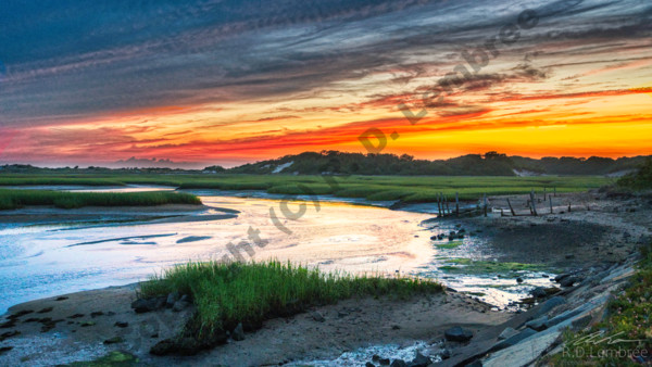 A summer sunset over Race Point in Provincetown, MA