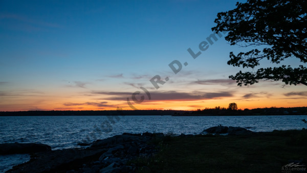 The sun sets over the bay on a late spring day on Mount Desert Island in Maine.