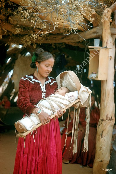 Woman with Child in Cradle