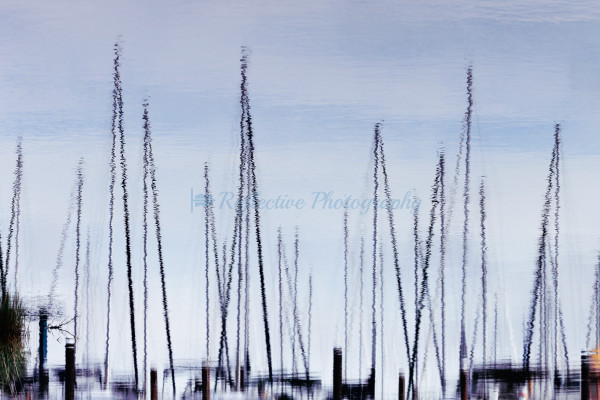 Fine Art Photograph of Reflection in Water of Sailboat Masts