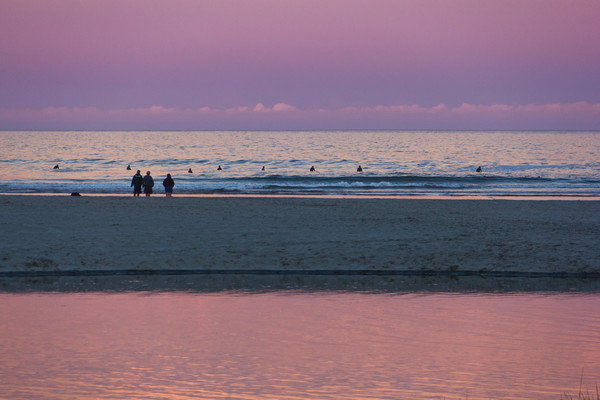 Spectators and Seal People at Dusk