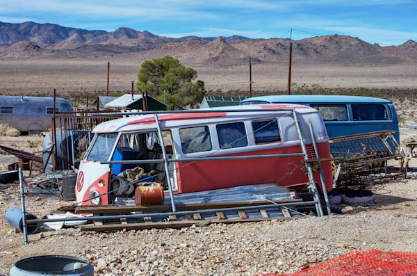 photo of dead vw busse in the california desert