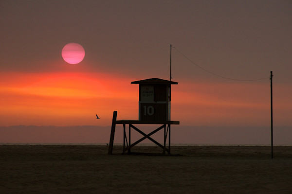 Lifeguard Stand with orange sky.