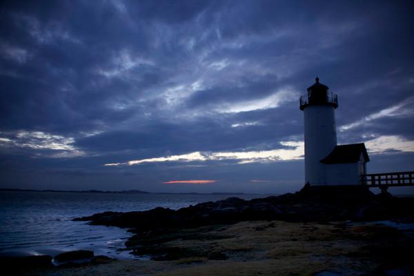 annisquam lighthouse beach sunset dark clouds seascape gloucester
