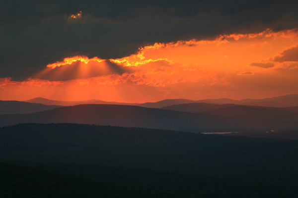 sun rays mountains clouds maine