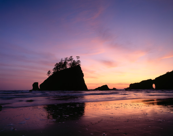 Sunset over sea stacks and an arch at 2nd Beach, Olympic National Park, Washington