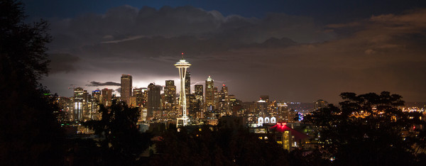 Lightning flash behind the downtown Seattle skyline, during a storm, Seattle, Washington