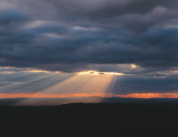 Crepuscular rays breaking out from behind a cloud