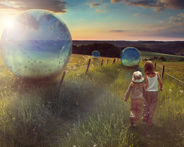 Two children enjoy a lazy summer day exploring and daydreaming in this digital image by Kim Whittemore.