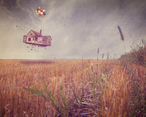 An old farmhouse, in total disrepair, is lifted up with balloons in this digital artwork by Kim Whittemore.