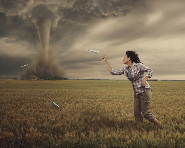 This is a self-portrait of the artist facing a tornado and making the best of it in this digital artwork by Kim Whittemore.