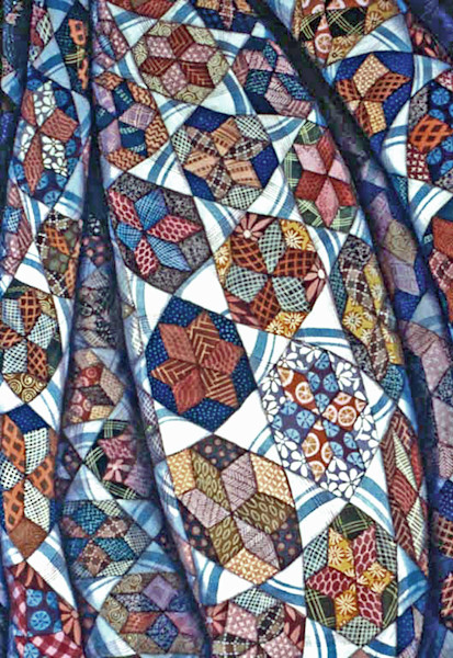 Giclee reproduction of an original watercolor by Helen Klebesadel of a multi-colored quilt