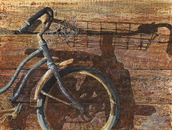 The shadow of an old bicycle reaches across the wall of a barn in this open edition print by Craig Cossey.