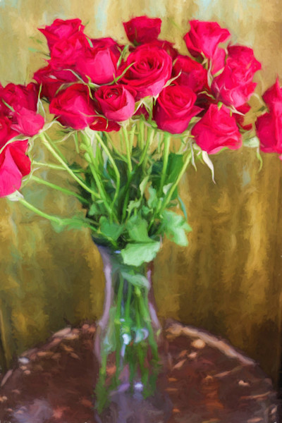 A bouquet of bright long stemmed roses and a crystal vase stand out against the neutral background in this Open Edition print by photographer Todd McPhetridge.