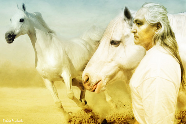 A white horse gallops past a silver haired Native American man standing next to another white horse in this Giclee of a Digital Photographic Painting by Robert Michaels.