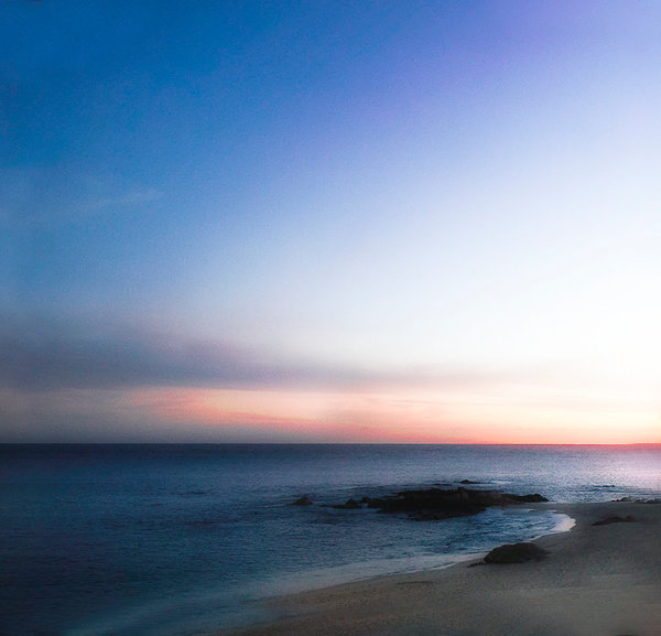 A moment of solitude on an empty beach, waiting breathlessly for the moment the sun edges over the horizon, is perfectly captured in this stunning print from a photograph by Ryn Clarke.