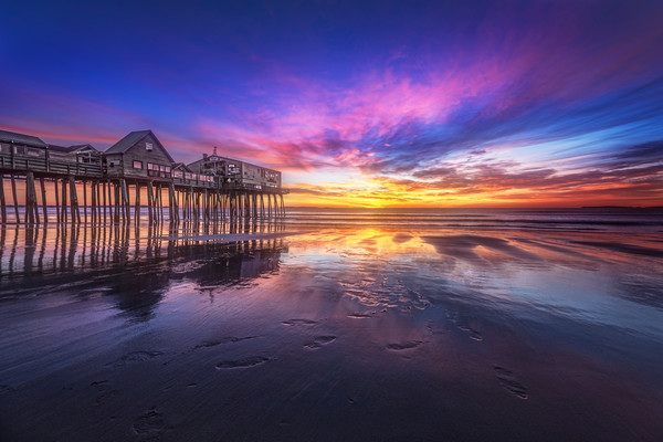 Old Orchard Beach Sunrise, the sky lights up behind the Pier at Old Orchard Beach, Maine