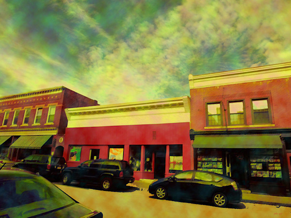 A city street is the landscape in this colorful eye-popping scene of Great Barrington, Mass by artist Paula Ogier.