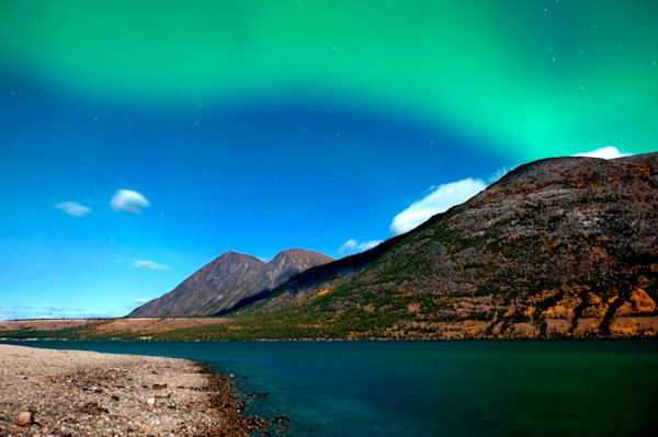 Northern Lights fill the night sky above Kusawa Lake in the Yukon Territory, Canada