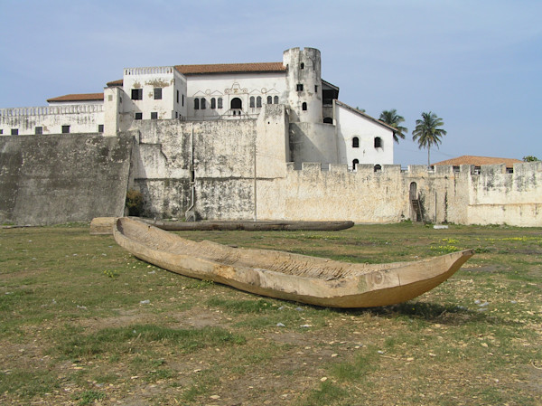 Hand-Carved Boat in Front of Elmina Castle