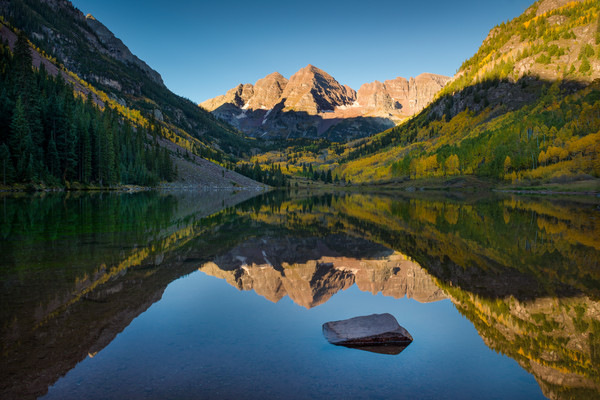 Photo of Aspen Maroon Bells in Colorado Reflecting Upon Maroon Lake