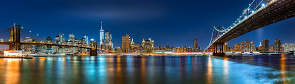 "Night panorama with the downtown New York City skyline and the ""Two Bridges"": Brooklyn Bridge and Manhattan Bridge, viewed from Brooklyn Bridge Park"