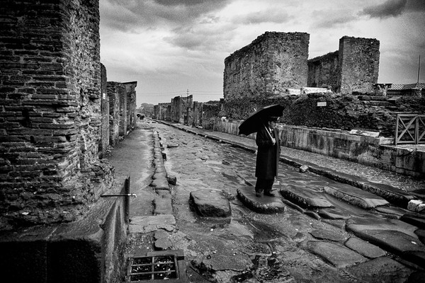 Man with Umbrella in Pompeii, Italy