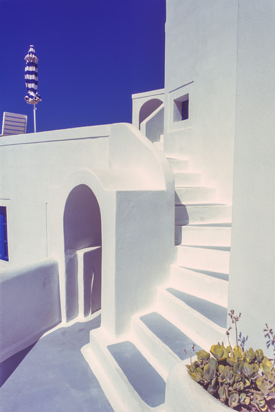 Villa, staircase and umbrella, Santorini, Greece