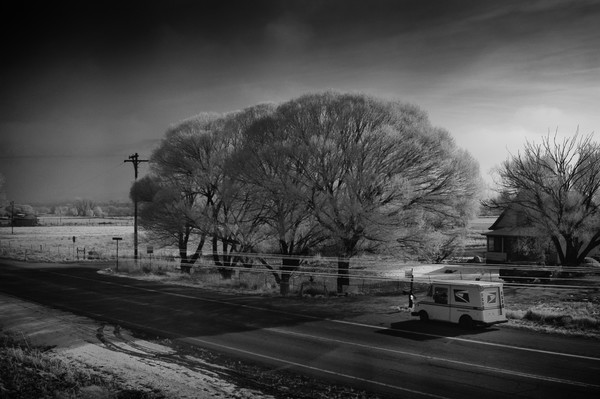 Mail Truck on Rural Colorado Road in Winter
