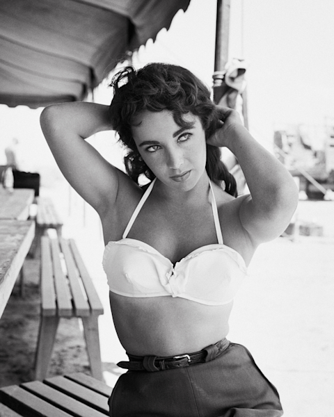 Elizabeth Taylor Portrait on the Set of Giant with her hands behind her head