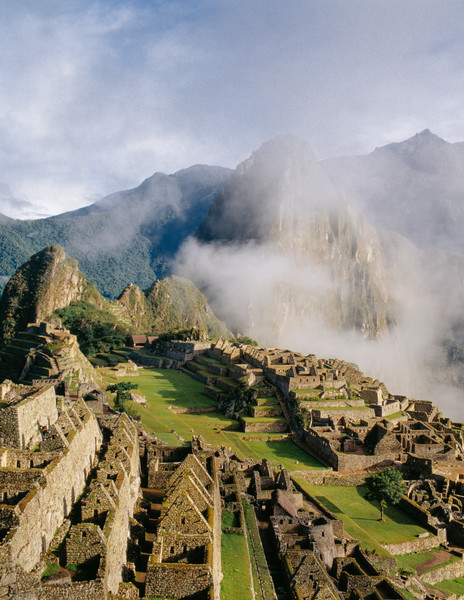 Machu Picchu thru lifting clouds high in the Andes Mountains of Peru