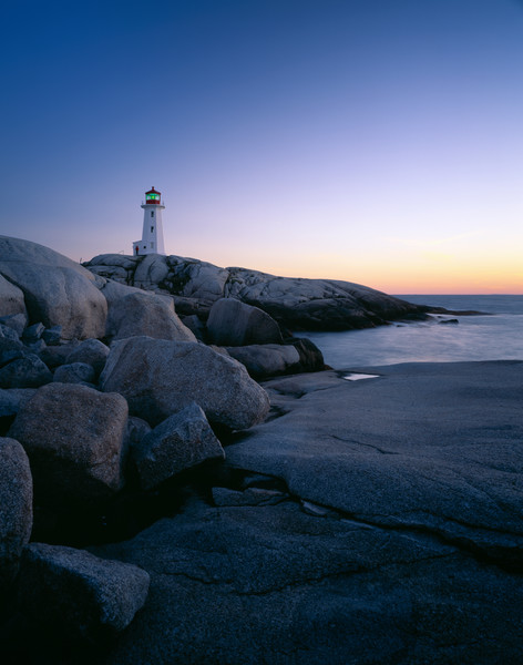 Peggy's Cove lighthouse on the rugged coast of Nova Scotia, Canada