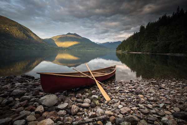 Canoe on Lake with Mountains at Sunset