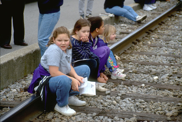 Kids rest on the railroad track during a parade in Frankfort, Ky.