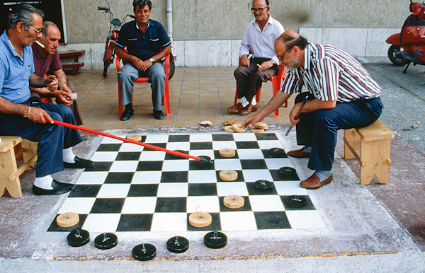 Slide 6404  Men playing checkers on a giant board in Agropoli, Italy.