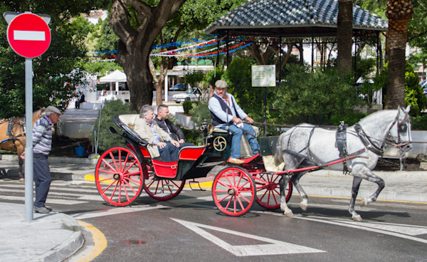 Tourists take a carridge ride in Mijas.