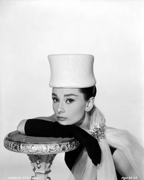 Audrey Hepburn leaning on a pedestal