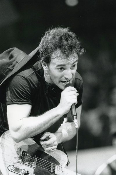 Bruce Springsteen holding the mic