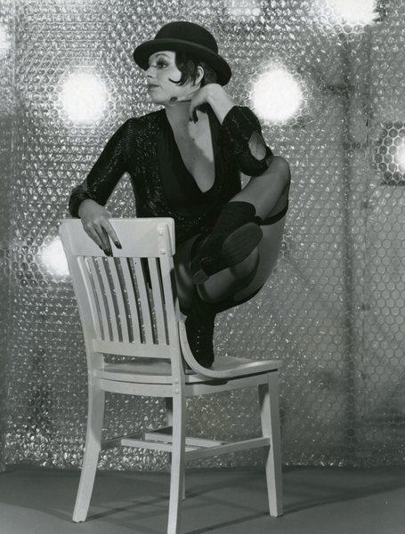 Liza Minnelli posing on a chair
